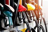 istock red green yellow orange color fuel gasoline dispenser  background 942599318