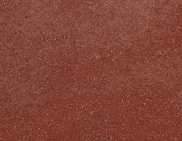 red ground textured background stock photo