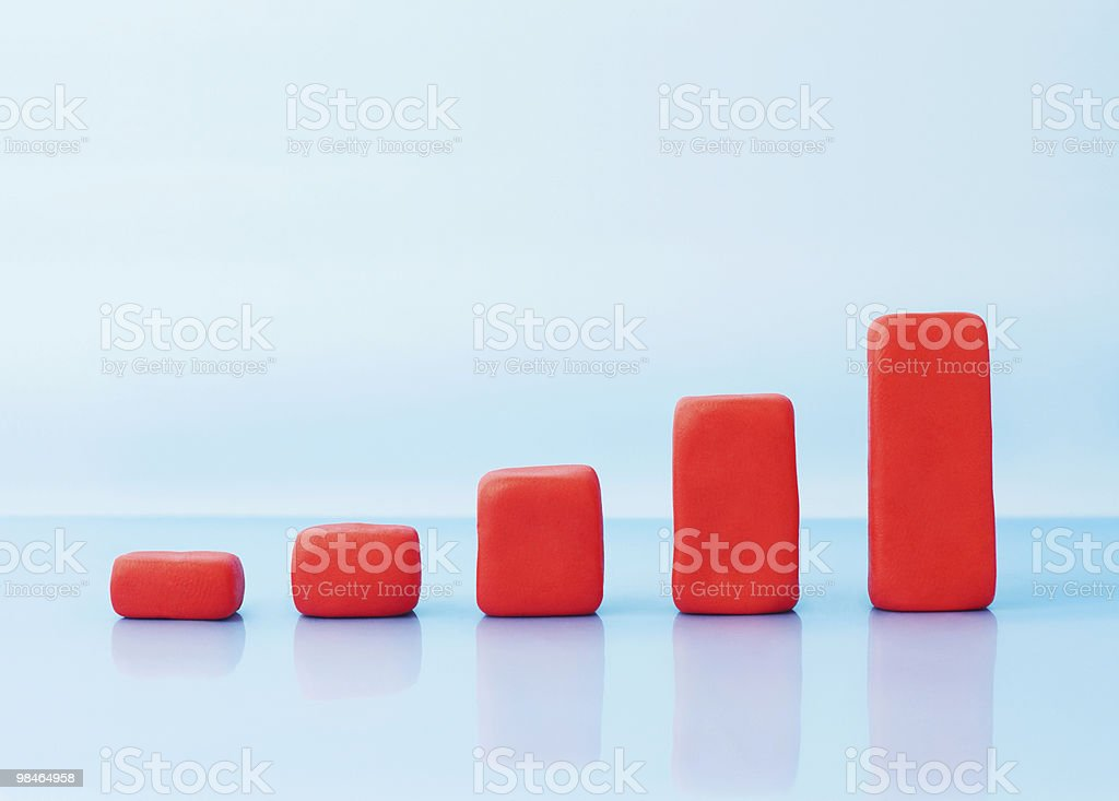 Red growing investment chart on blue royalty-free stock photo