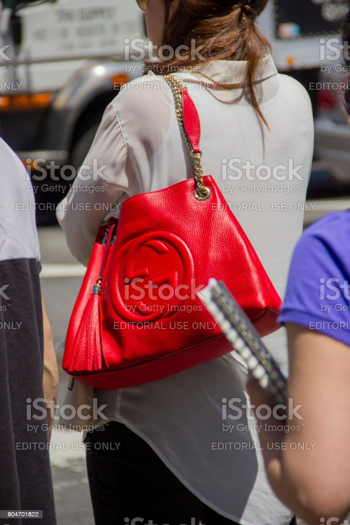 Red gucci bag on the street in new york stock photo