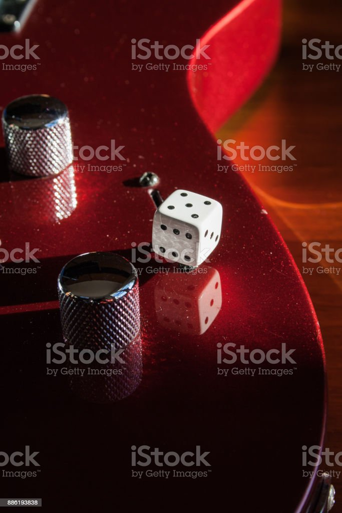 Red guitar body with strings, riff  and switch stock photo