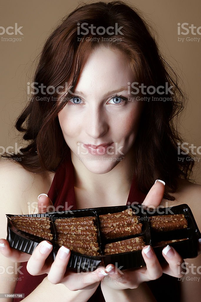 Red hair female holding a box of chocolate royalty-free stock photo