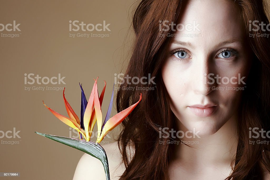 Red hair female holding flower royalty-free stock photo