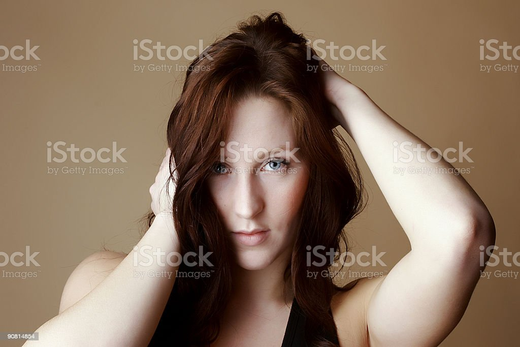 Red hair female with hands around head royalty-free stock photo