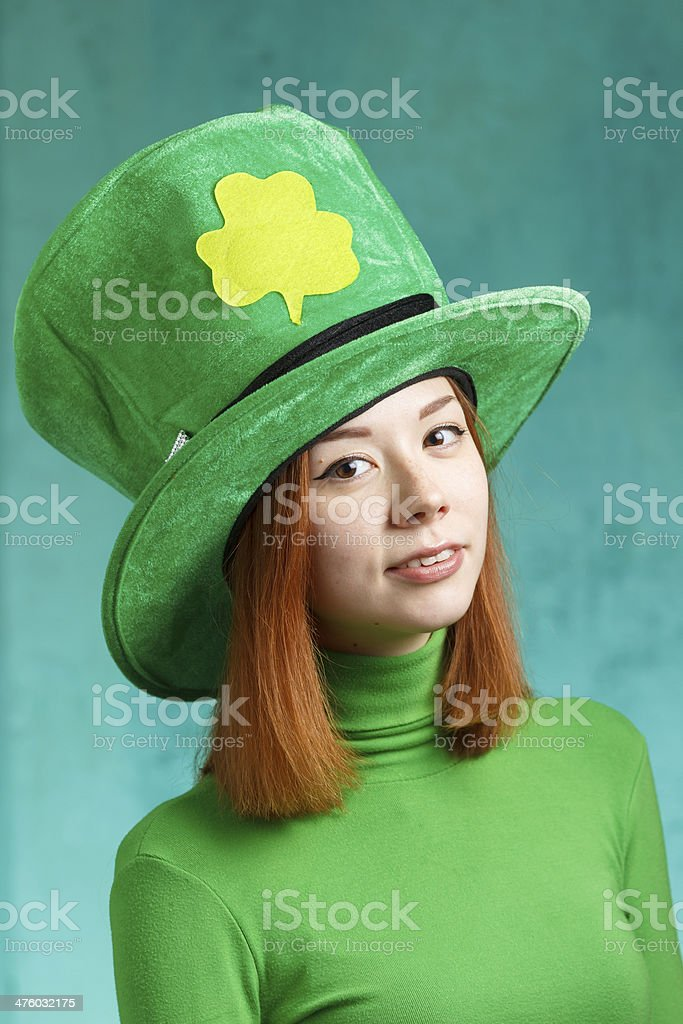 Red hair girl in Saint Patrick's Day leprechaun party hat stock photo