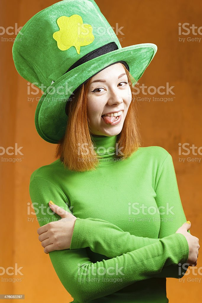 Red hair girl in Saint Patrick's Day party hat stock photo