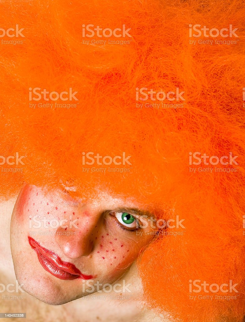 Red haired angry tired man with a clown make-up royalty-free stock photo