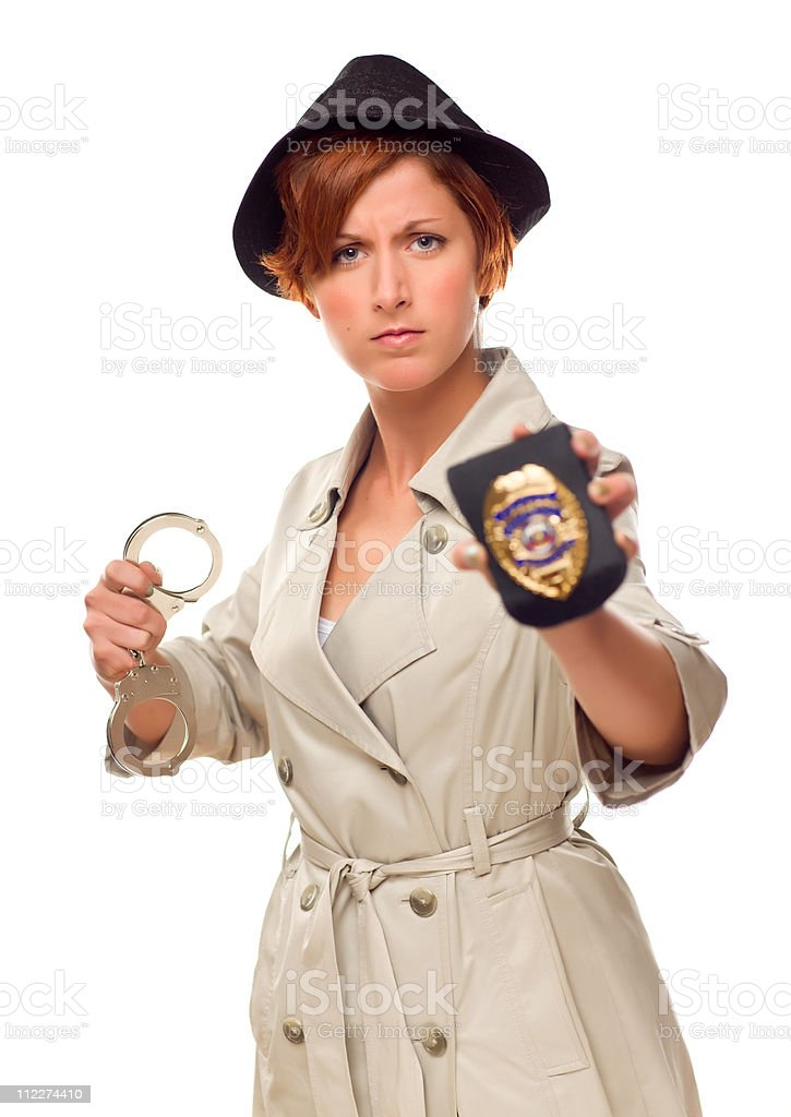 Red Haired Female Detective With Handcuffs and Badge In Trenchco stock photo