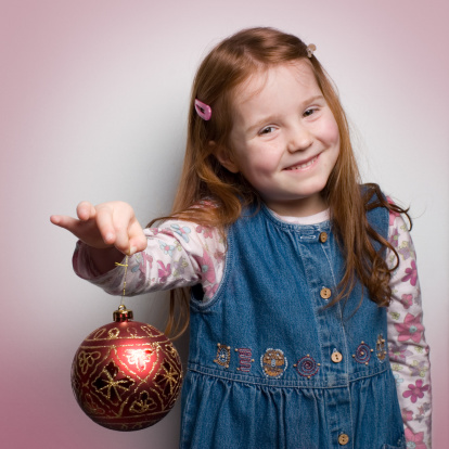 Red Haired Girl Holding A Piece Of Decoration Stock Photo - Download Image Now