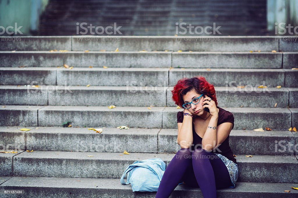 Red haired girl talking on the phone stock photo