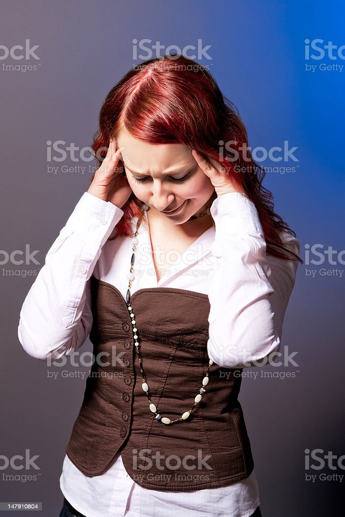 red haired girl with headache royalty-free stock photo