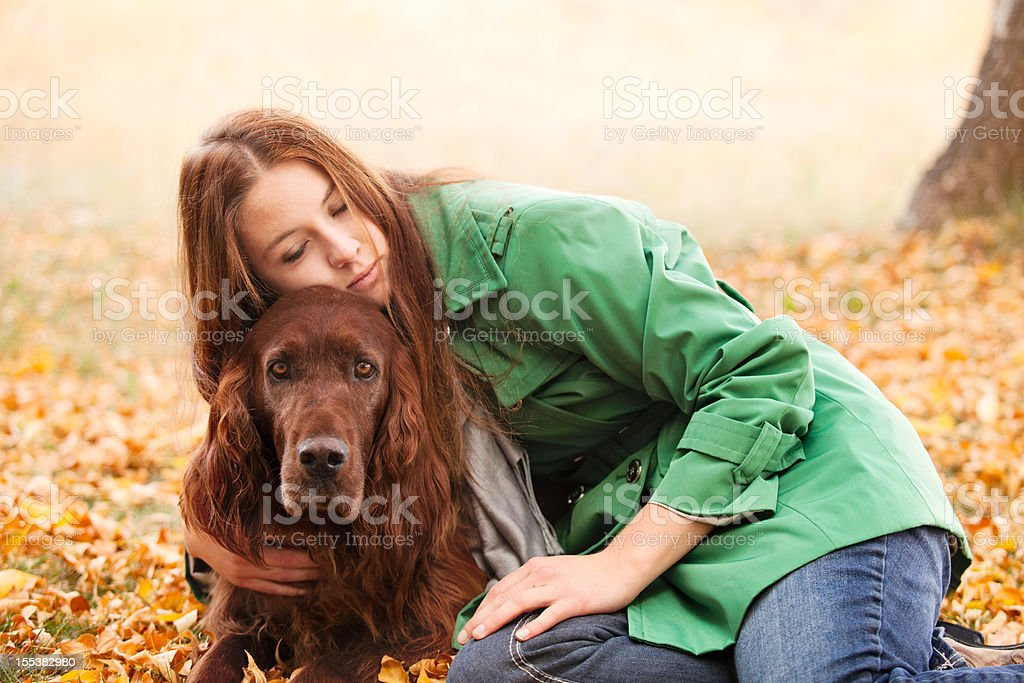 Red Haired Woman Embracing & Loving Irish Setter Dog stock photo