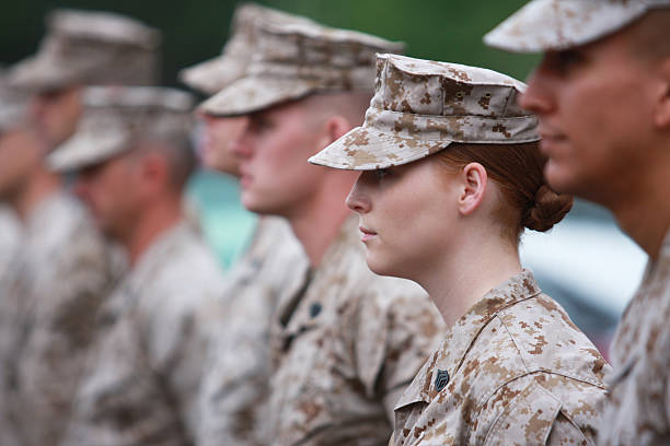 red haired woman marine in formation - marines stock photos and pictures