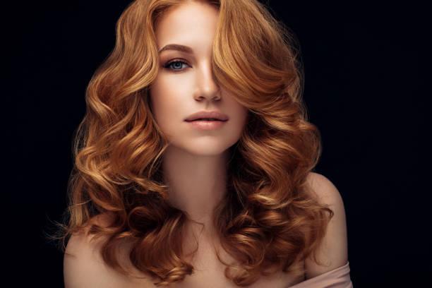 red haired woman - capelli mossi foto e immagini stock