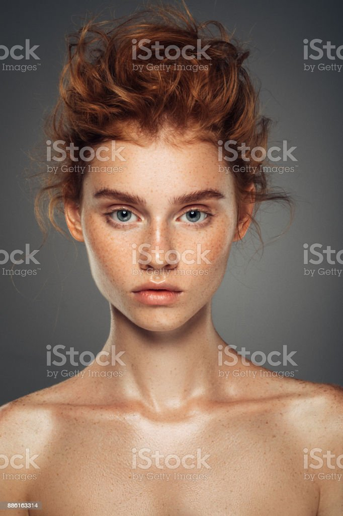 Red haired woman with shiny and curly hairstyle stock photo