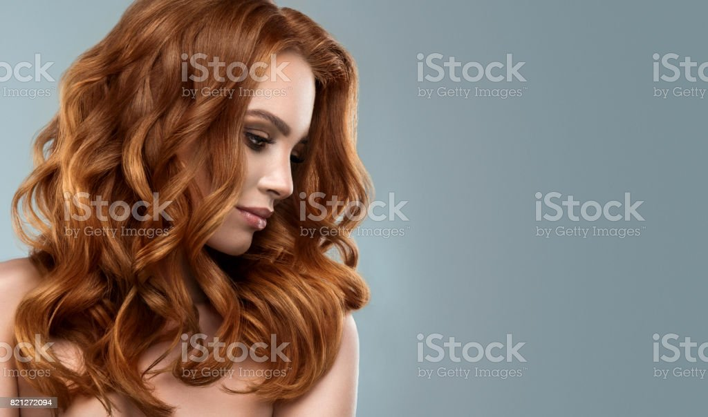 Red haired woman with voluminous, shiny and curly hairstyle.Flying hair. royalty-free stock photo