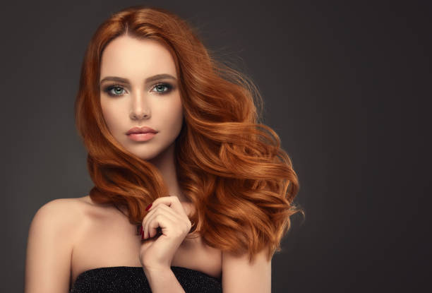 red haired woman with voluminous, shiny and curly hairstyle.flying hair. - human hair stock photos and pictures
