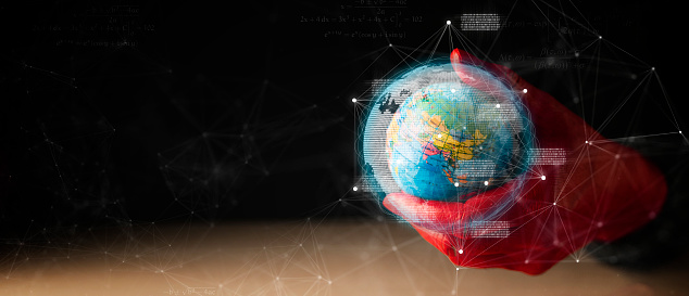 917493152 istock photo red hand metaphor hold earth toy model dark background with virtual graphic communication technology ideas concept 1213867470