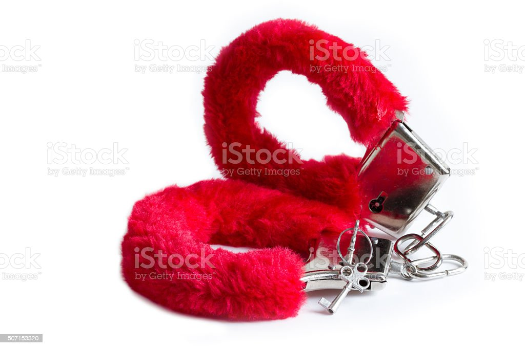 Red handcuffs stock photo