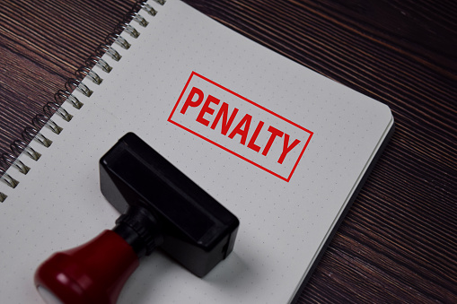 Red Handle Rubber Stamper and PENALTY text isolated on White Background.
