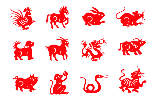 Red handmade cut paper chinese zodiac animals isolated on white background
