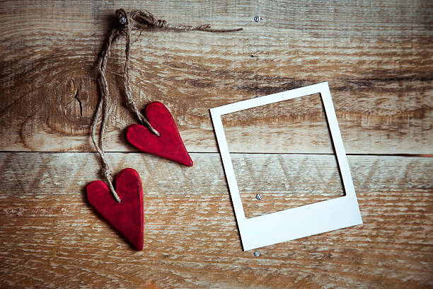 red handmade hearts with polaroid frame over old wooden background - recycling heart bildbanksfoton och bilder