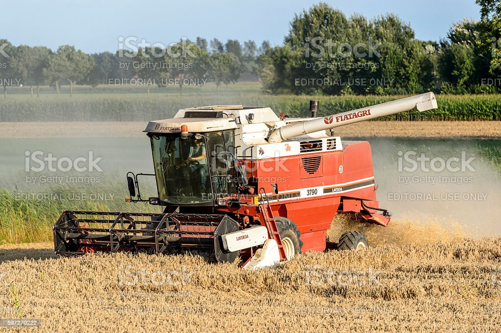 Red harvester on the field royalty-free stock photo