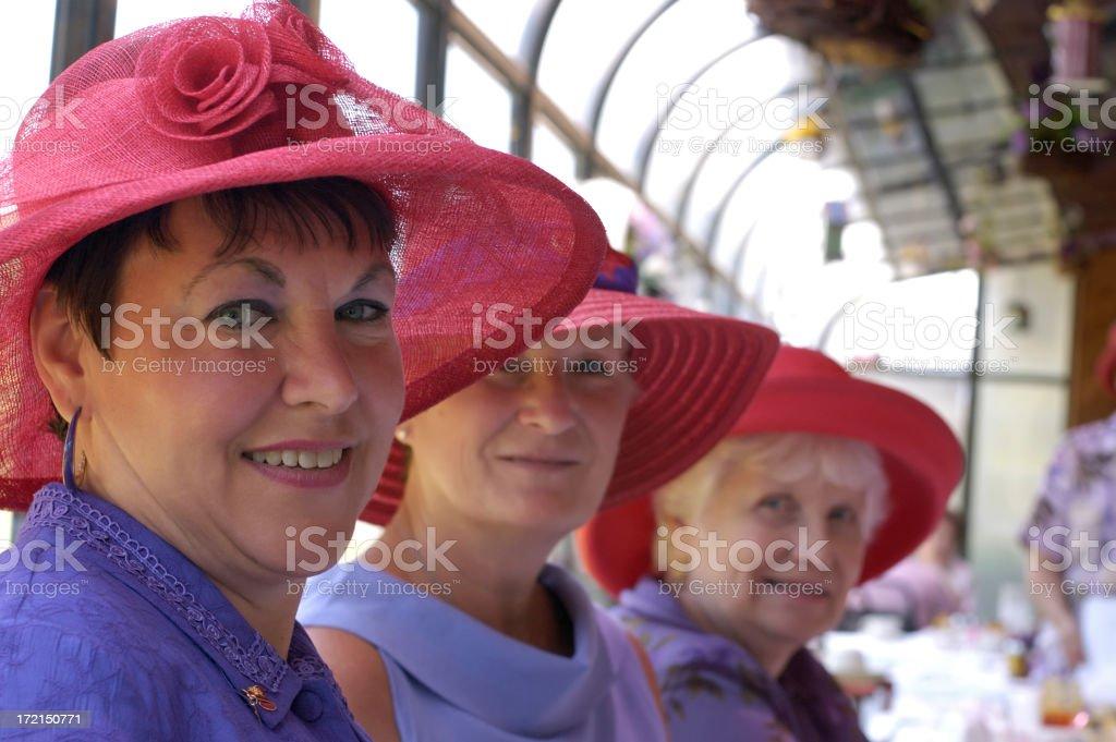 Red hats ladies stock photo