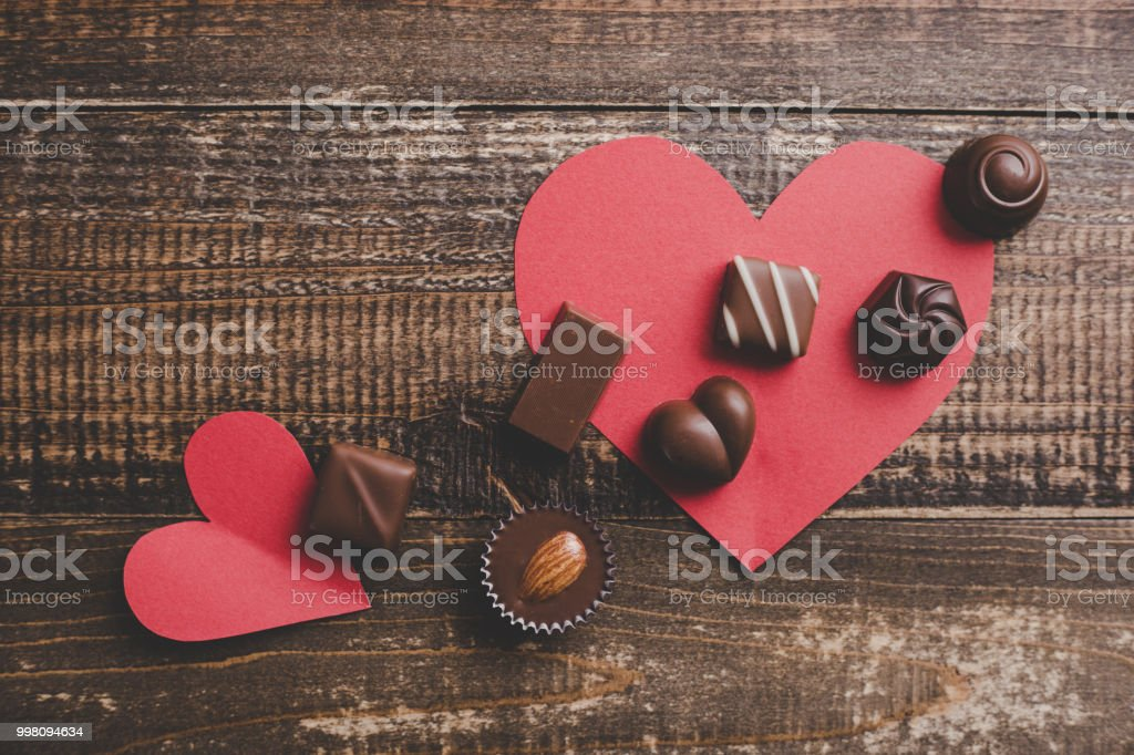 red heart and a lots of chocolate stock photo