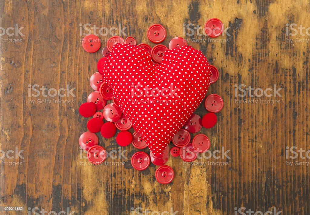 Red heart and buttons stock photo