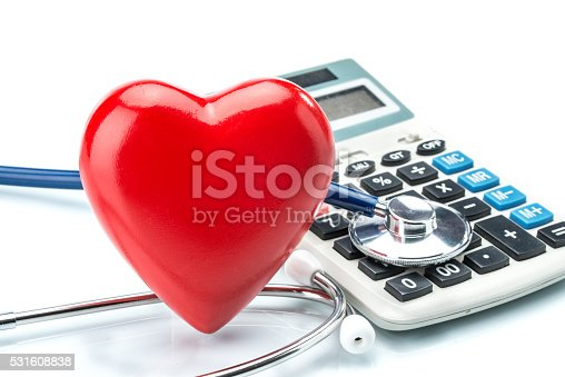 istock Red heart and calculator with stethoscope on white background 531608838