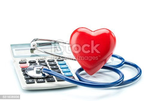 istock Red heart and calculator with stethoscope on white background 531608936