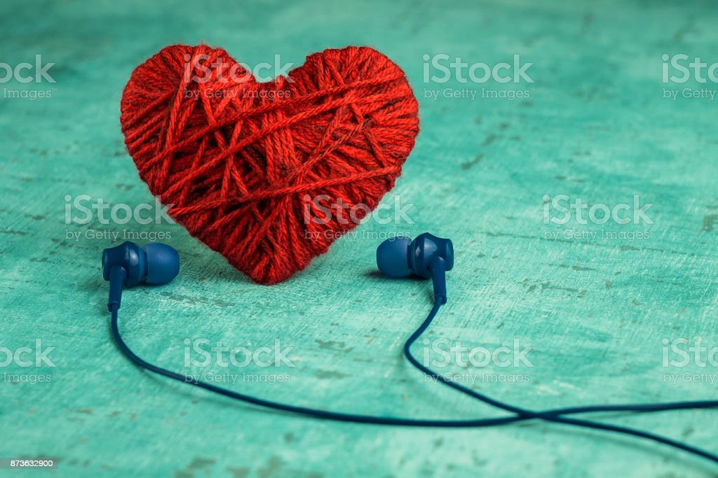 Red heart and headphones. Listening to favorite music stock photo