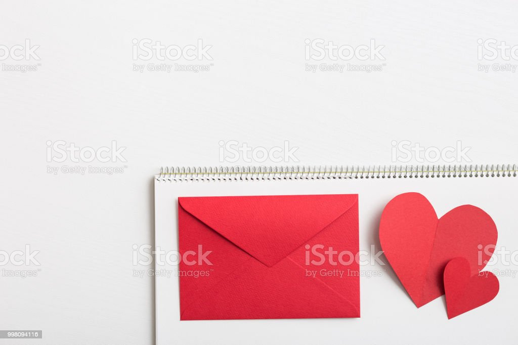 Red heart and love letter on the white sketchbook stock photo