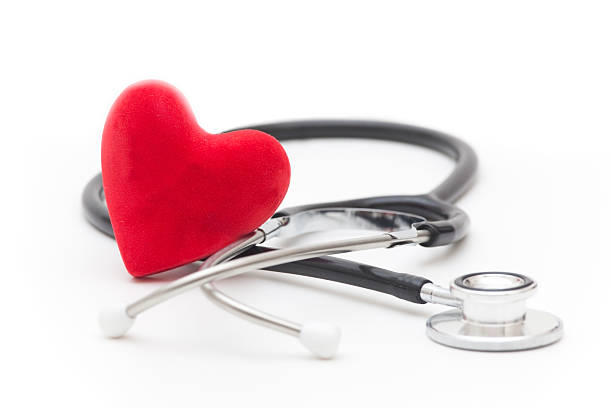 Red heart and stethoscope on a white background stock photo