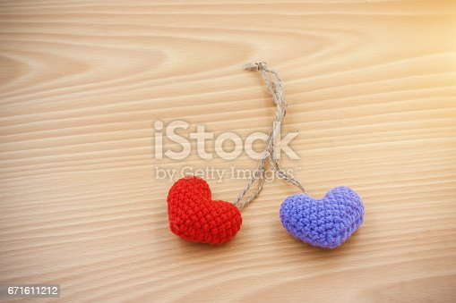 istock Red heart and violet heart made from Yarn place on wooden background 671611212