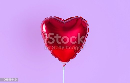 1078237178 istock photo Red heart balloon isolated on lilac background. Creative minimal love concept. 1066594424