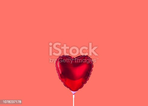 istock Red heart balloon isolated on trendy background. Color of the year 2019. 1078237178