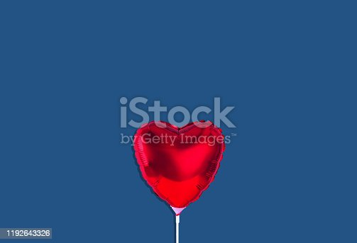 1078237178 istock photo Red heart balloon isolated on trendy background. Color of the year 2020. 1192643326