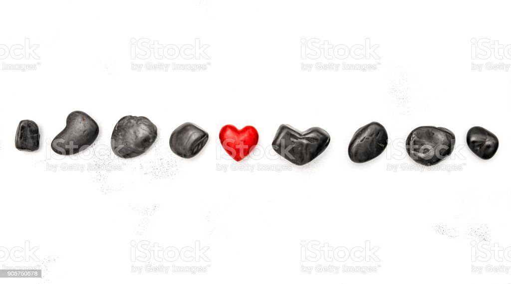 Red heart black stones Love Valentines Day background stock photo