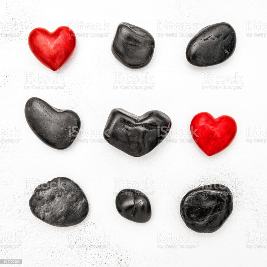 Red heart black stones Love Valentines Day Flat lay background stock photo