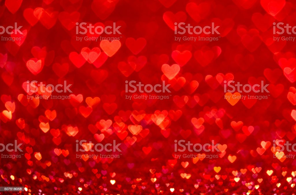Red heart bokeh background. Valentines day texture. stock photo