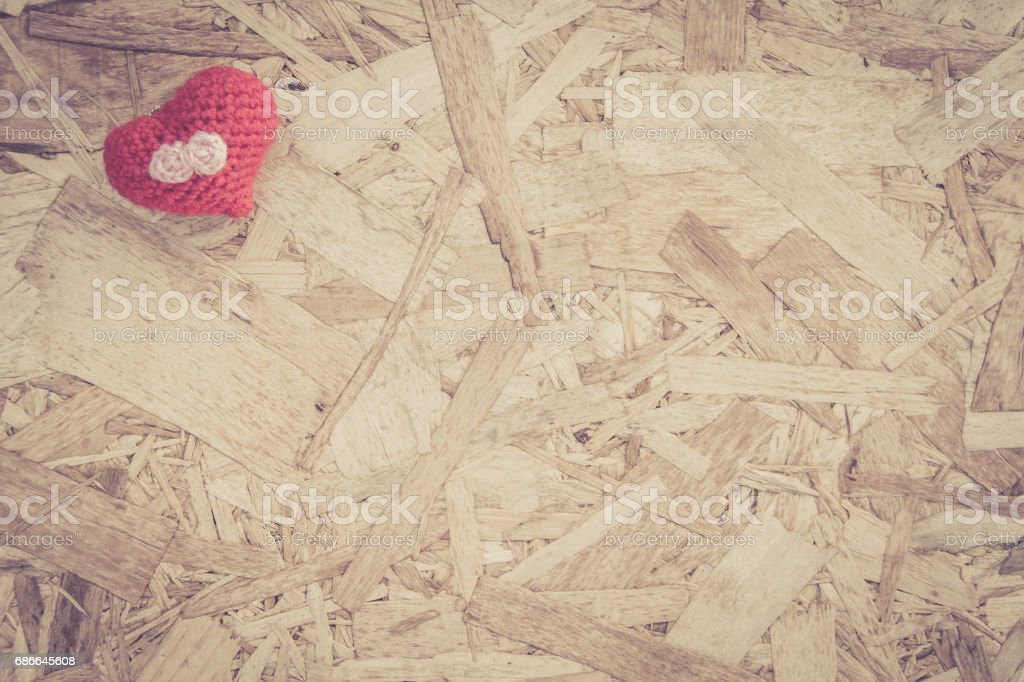 Red heart Crochet on plank wood. vintage top view background royalty-free stock photo