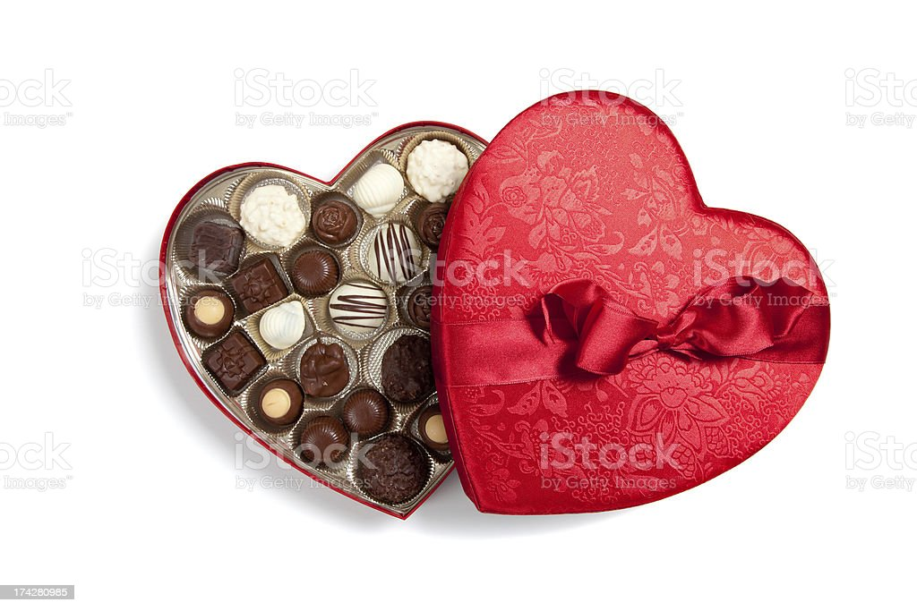 Red heart full of chocolates on white stock photo