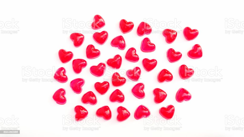 Red heart gummy candy on a white background. stock photo