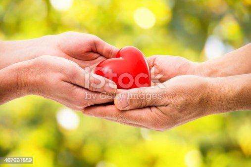 istock Red heart in human hands 467661889