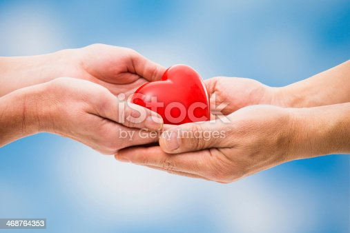 istock Red heart in human hands 468764353