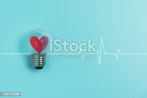 Red heart in light bulb with Heartbeat pulse on blue background. Valentine's day, Creative idea, Health care Concept.