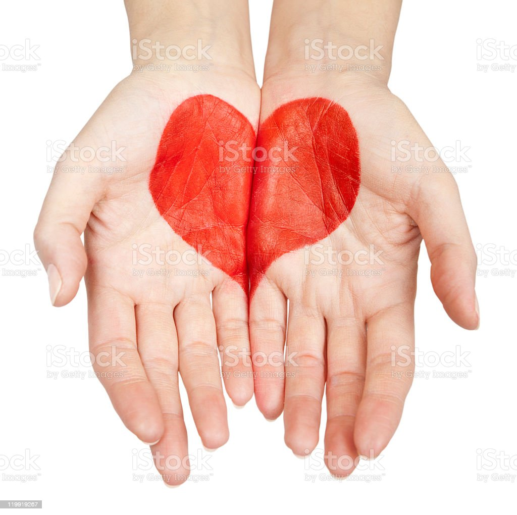 red heart in the palms of a woman royalty-free stock photo