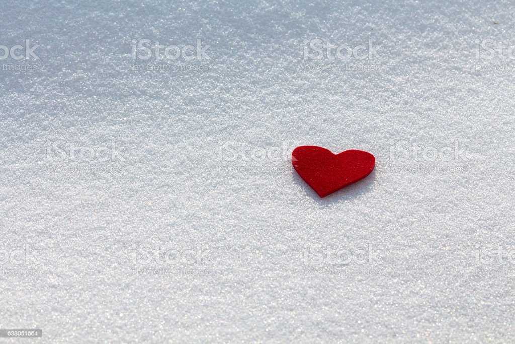 Red heart in the snow stock photo